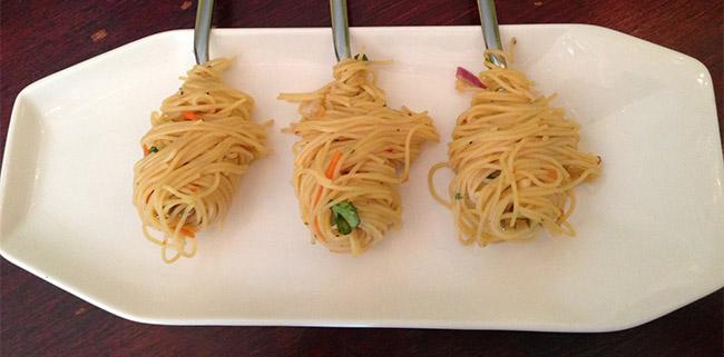 Noodles on forks on plate